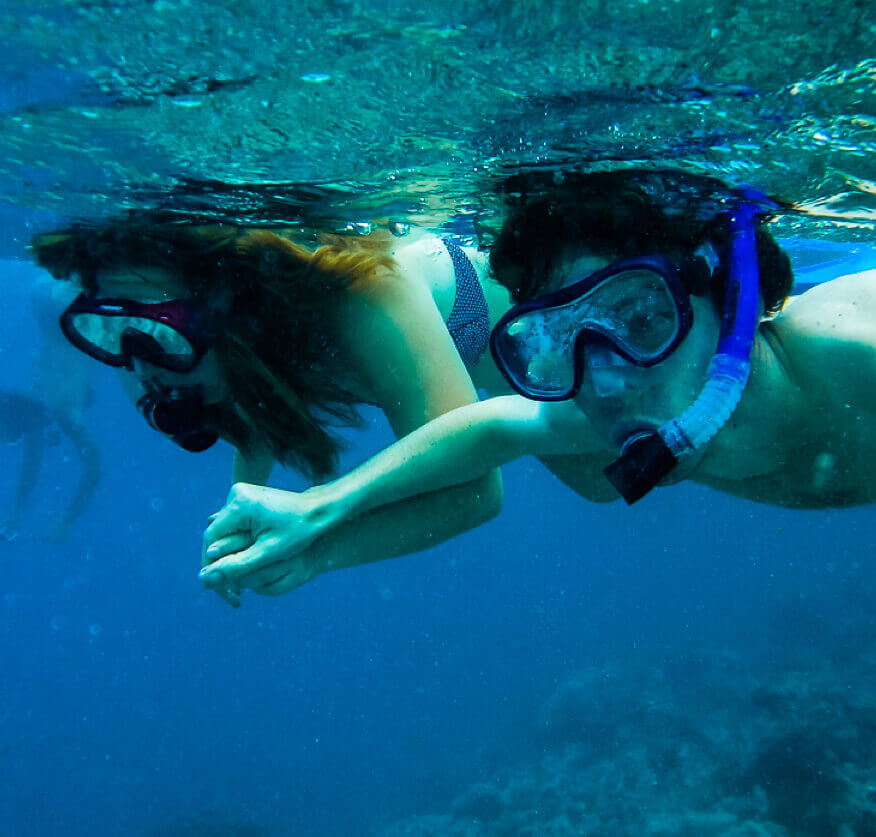 Boy and girl snorkelling